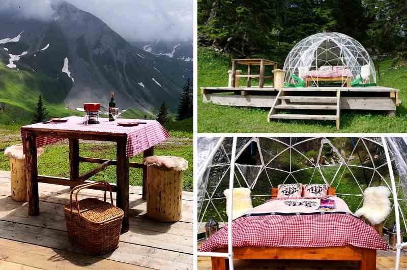 Zur Bubble Übernachtung auf der Klewenalp über dem Vierwaldstättersee bei Interlaken gibt es als Schweizer Nationalgericht ein Fondue Essen vor imposanter Bergkulisse